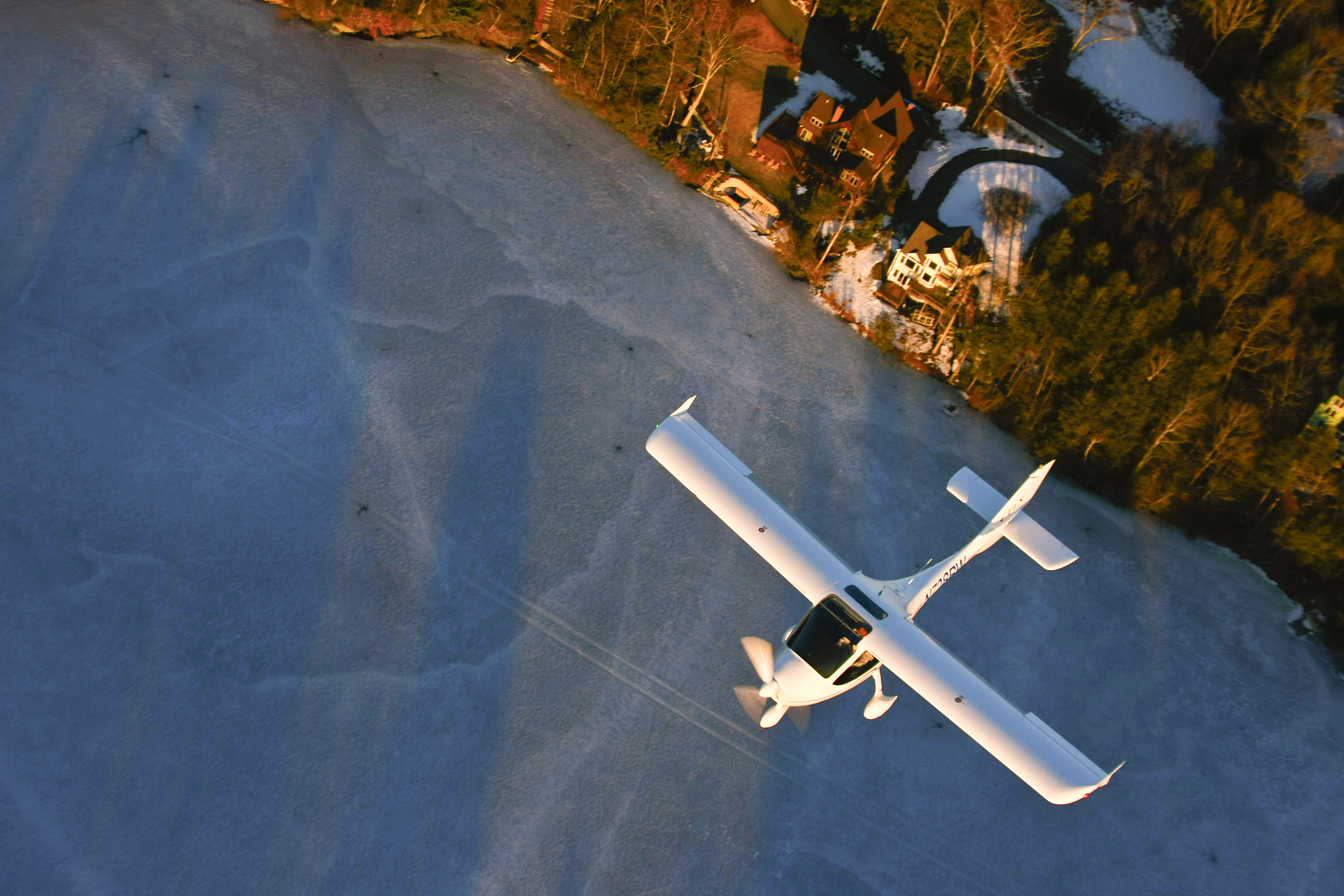 Inflight over frozen lake from above